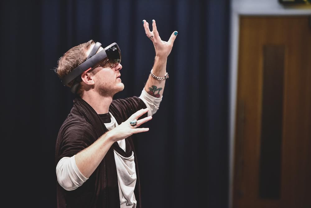 Choreographer creating movement with arms wearing AR equipment