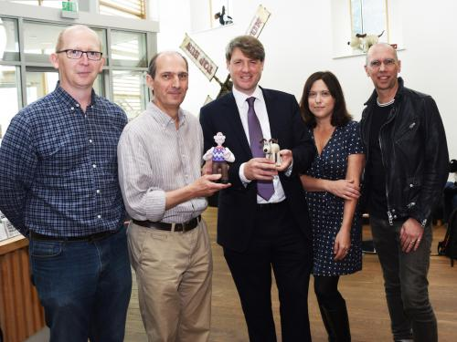 "Jason Veal of Sugar Creative, David Sproxton of Aardman, Chris Skidmore MP , Minister for Business Energy and Industrial Strategy, Susan Cummings of Tiny Rebel Games, and Scott Ewings of Potato London, together with ""lifesize"" models of Wallace and Gromit, at Aardman in Bristol."