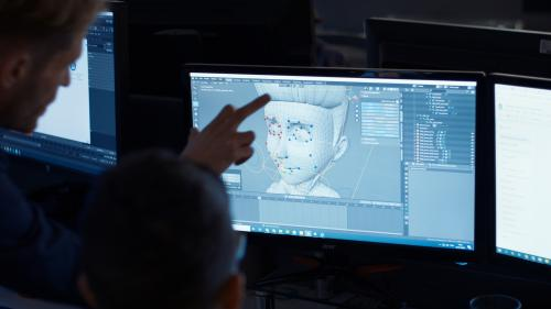 Jon Rennie, MD of Cloth Cat Animation, pointing at animation on computer screen